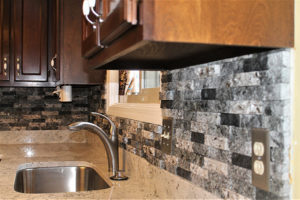 Southern Gray Granite with NVRG Backsplash - sink wall