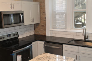 Black Pearl Granite Kitchen with Romanix Granite Island