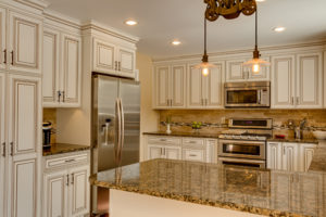 Advantage Cabinetry - Andale Maple with White Burnt Glaze Cabinetryq