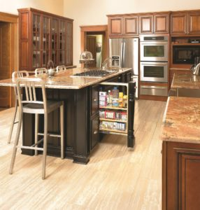 Advantage Cabinetry - Easton Door Profile. Maple with Black Finish Island features slide out storage.