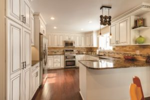 Advantage Cabinetry - Andale Door Profile. Maple with White with Burnt Glaze.