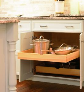 Roll-out trays are great for storing pots and pans, lids and more. And it's easy to access the stuff in the back too!