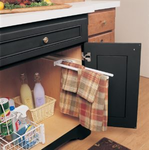 Keep your kitchen towels out of site yet easily accessible with a slide out towel bar mounted in the sink base cabinet.